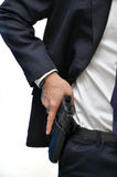 Man with gun. Agent wearing white shirt drawing gun from holster royalty free stock photos