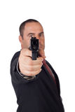 Man with a gun. Ready to shoot (focus on the weapon Royalty Free Stock Photo