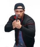Man with gun. Serious man holding handgun on a white background stock photos