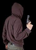 Man with gun. In studio Stock Image