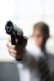 Man with gun. A man with a pistol Stock Photos
