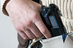 Man with Gun. Tucked into his jeans Stock Images