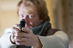 Man with Gun. Man with a black gun aiming towards the camera Royalty Free Stock Photos