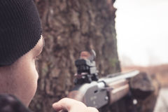 Man with gun aiming and prepared to make a shot during hunting Royalty Free Stock Photo