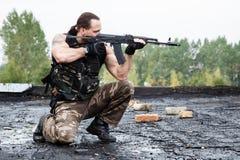 Man with a gun Stock Photo