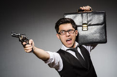 Man with gun. And briefcase royalty free stock photo