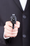 Man with gun, business suit Royalty Free Stock Photo