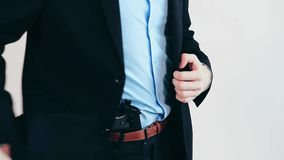 Man with gun, business suit stock footage