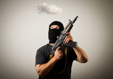 Man with gun and cloud. Royalty Free Stock Photo