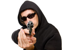Man with gun, focus on the gun Stock Images