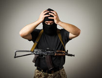 Man with gun. Frustrated man wearing balaclava with a gun. Headache concept royalty free stock photography