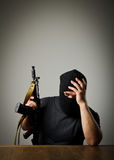 Man with gun. Frustrated man wearing balaclava with a gun. Headache concept royalty free stock images