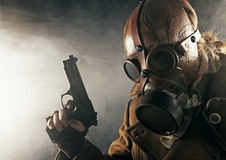 Man with gun in gas mask Royalty Free Stock Photos