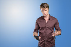 Man with gun and handcuffs stock photo