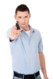 Man with gun. Man holding handgun and aiming Royalty Free Stock Photo