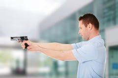 Man with gun. Man holding handgun and aiming Stock Photo