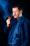 Man with Gun Holstered Smoking Pipe Stock Photos