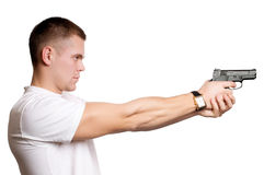 Man with gun isolated Stock Images