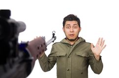 Man with a gun isolated on the white Stock Photo