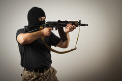 Man with gun Stock Images