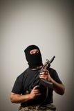 Man with gun. Man in mask with gun stock photos