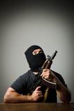 Man with gun. Man in mask with gun royalty free stock photo