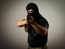 Man with gun. Man in mask with gun. Russian terrorist stock images