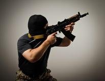 Man with gun. Man in mask with gun. Russian terrorist royalty free stock photo