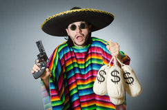 The man with gun and money sacks Stock Image