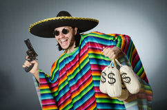 The man with gun and money sacks Royalty Free Stock Photography