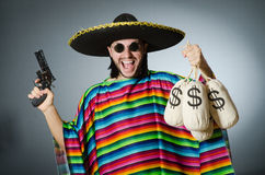 Man with gun and money sacks Stock Image