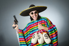 Man with gun and money sacks Royalty Free Stock Photo