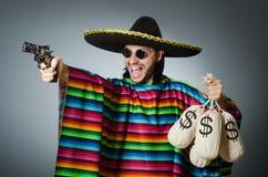 The man with gun and money sacks Stock Photos