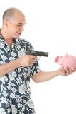 Man with gun pointing at piggy bank Royalty Free Stock Image