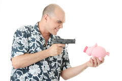 Man with gun pointing at piggy bank Royalty Free Stock Photography