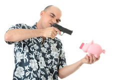 Man with gun pointing at piggy bank Stock Photography
