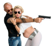 Man with a gun and pregnant woman Stock Images