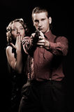 Man with gun protecting his woman Royalty Free Stock Photos