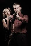 Man with gun protecting his woman. Retro portrait royalty free stock photos