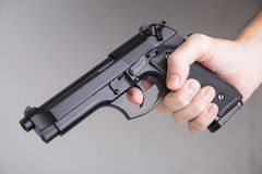 Man with a gun ready to fire Stock Photography