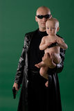Man with gun and son. Man with gun holds his son Royalty Free Stock Photo