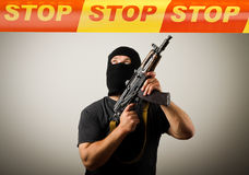 Man with gun and STOP line. Royalty Free Stock Photos