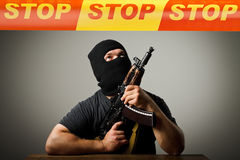 Man with gun and STOP line. Stock Photo