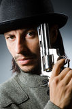 Man with gun. And vintage hat Royalty Free Stock Photography