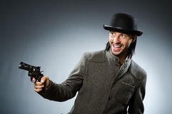 Man with gun. And vintage hat Stock Photography