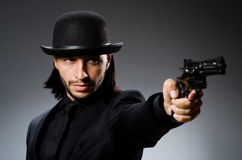 Man with gun. And vintage hat Stock Image