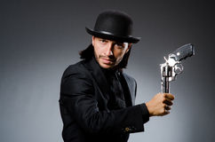 Man with gun. And vintage hat Royalty Free Stock Photo