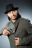 Man with gun. And vintage hat Royalty Free Stock Images