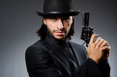 Man with gun. And vintage hat Stock Images