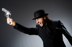 Man with gun. And vintage hat Stock Photo